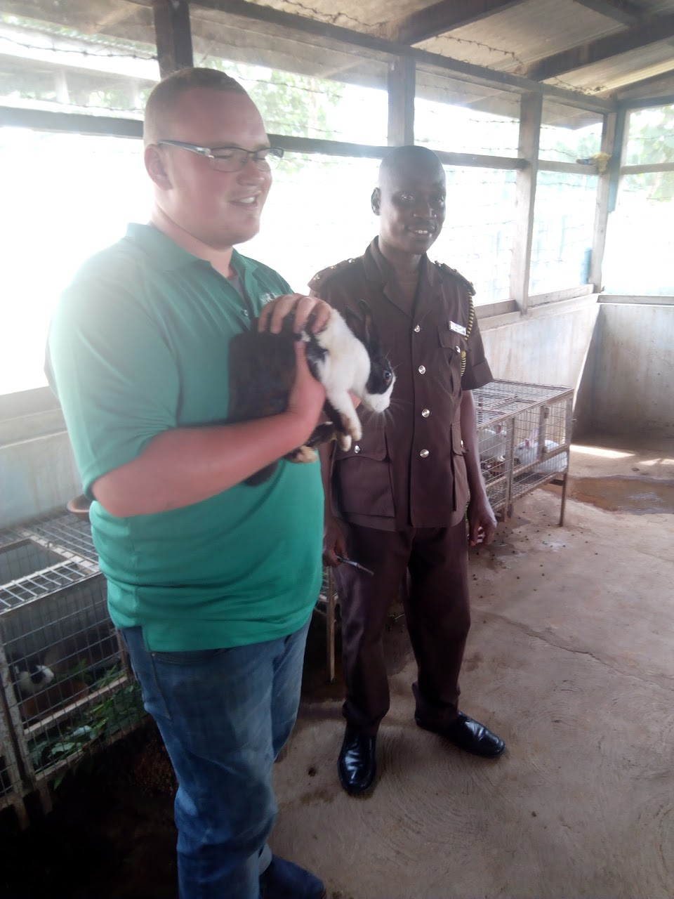 staff member and prison officer hold rabbits